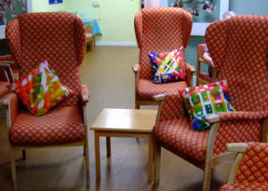 colourful cushions in the lounge, art in care homes