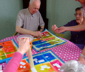 peeling tape off the printed fabric, art in care homes