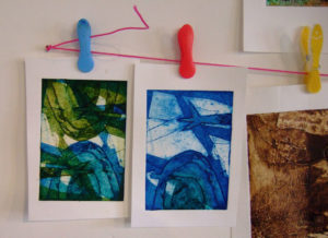 string and pegs to display prints
