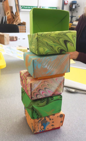 tower of folded marbled paper boxes