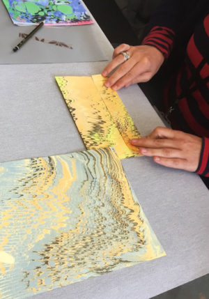 folding marbled paper for bags
