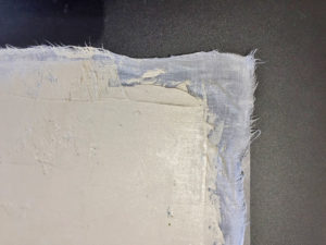 Tile cement spread onto wet cotton fabric