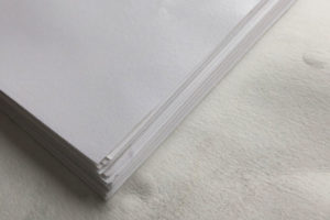a stack of lovely damp printing paper