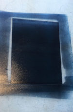 a thin layer of ink rolled on the acetate