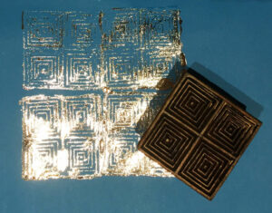 a block print gilded with toner foil