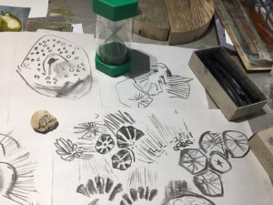 One minute egg timer with coral and charcoal drawings