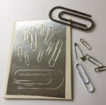 Embossed plate made with paperclips