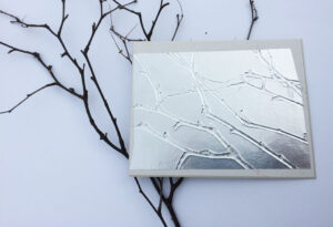 Embossed aluminium plate made with a twig