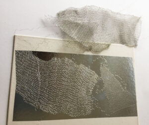 Embossed plate made with wire mesh