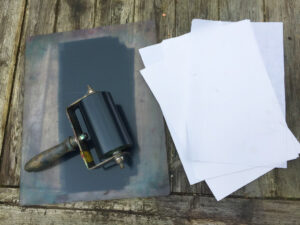 All you need is perspex with ink, a roller and paper