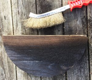 Use a wire brush to clean the wood grain