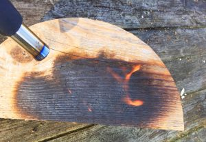 scorching wood grain with a blow torch