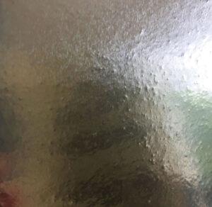 glue texture shows under the kitchen foil