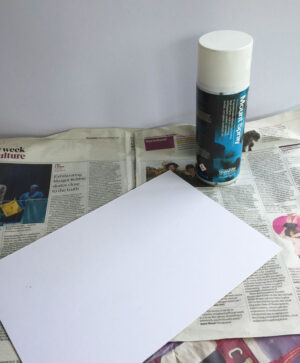 spray glue on a piece of card