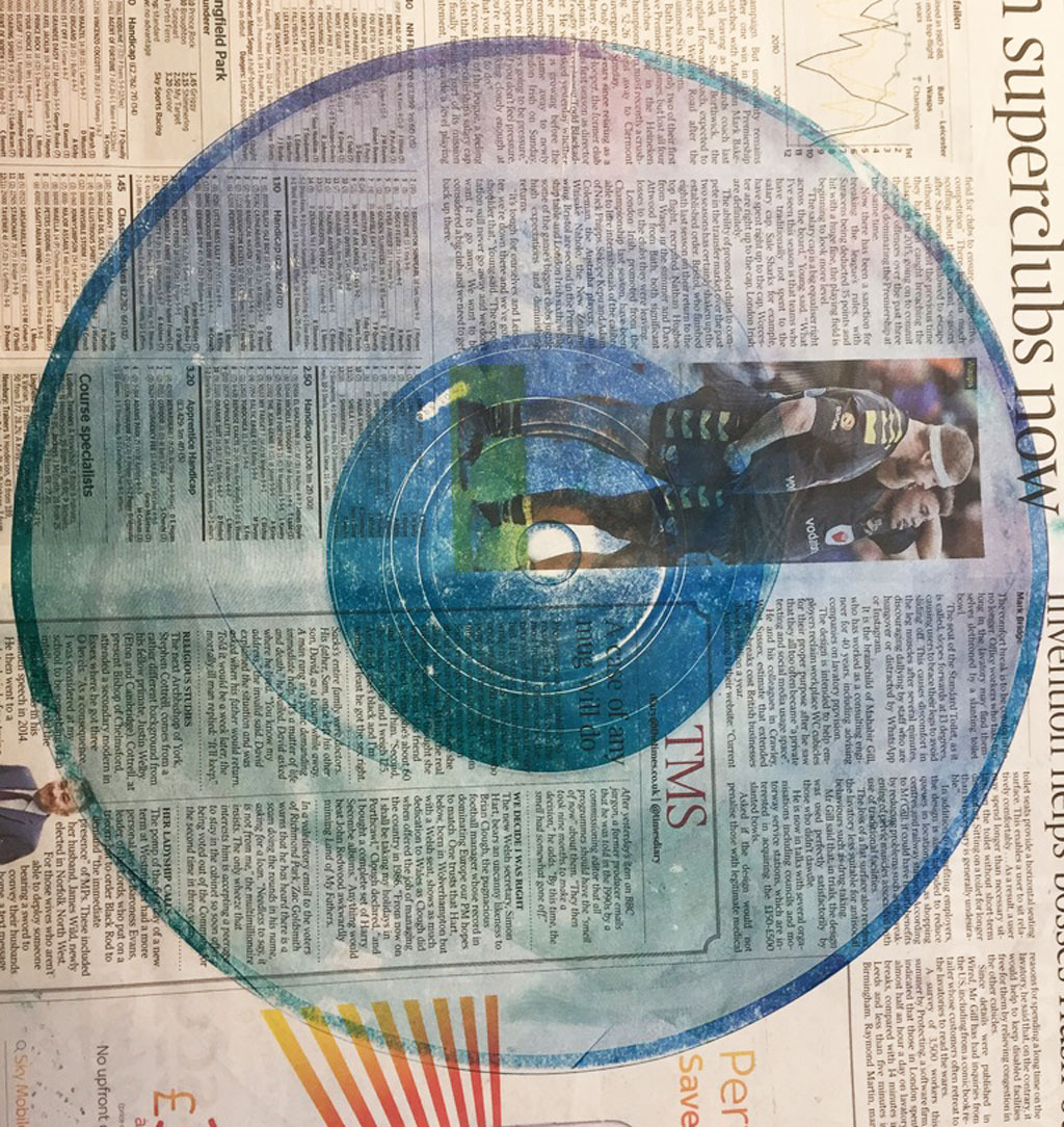 a vinyl record print on newspaper