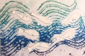 inked up fish laid on print