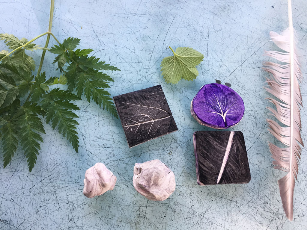 plasticine printing blocks from leaves and feathers