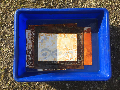 washing rust prints in water